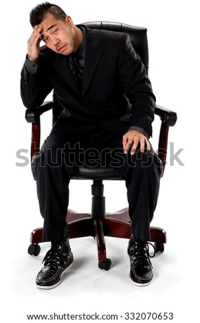 Sad Asian man with short black hair in business formal outfit with hands on thighs - Isolated