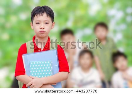 Sad asian school boy at school - stock photo