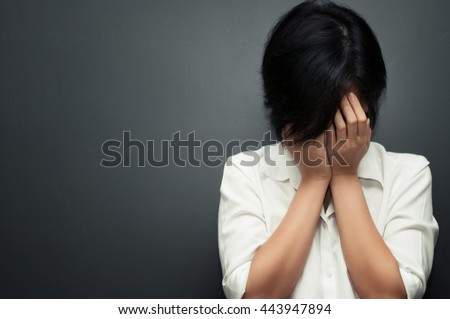 Sad asian woman cry and depressed with copy space.  Illness concept. - stock photo