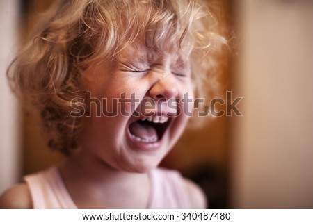 Sad baby. Crying  little girl - stock photo