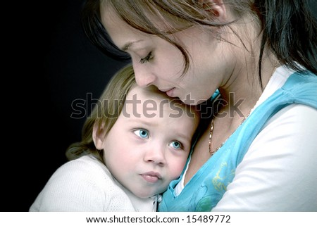 Sad baby in the lap of mommy - stock photo