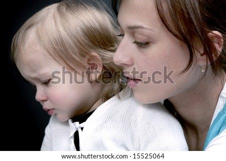 Sad baby with mother, isolated - stock photo
