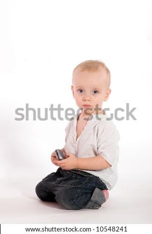 Sad baby with phone isolated on white - stock photo