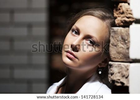 Sad beautiful woman on the night city street - stock photo