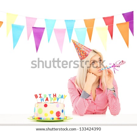 Sad birthday girl with a cake isolated on white background - stock photo