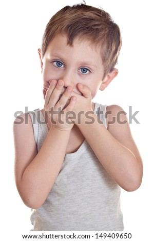 Sad boy covers his mouth palms - stock photo