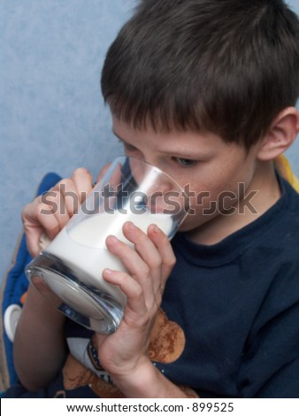 sad boy drinking milk