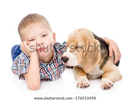 Sad boy hugging beagle puppy. isolated on white background - stock photo