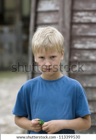 Sad boy of outdoor - stock photo