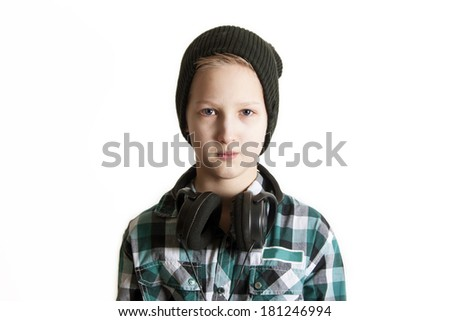 sad boy with earphones - stock photo