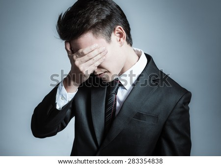 Sad business man. - stock photo