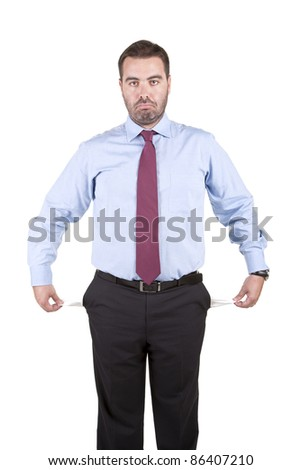 sad business man showing his empty pocket against white background - stock photo
