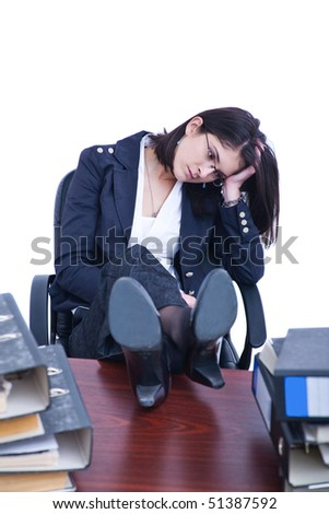 Sad business woman contemplating pile of folders and binders.