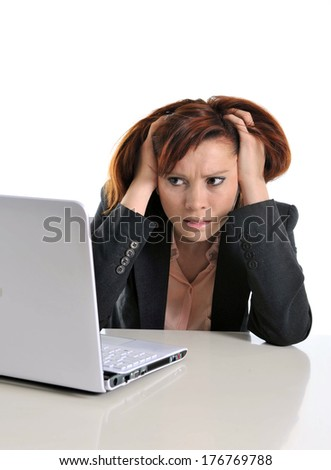 sad business woman in stress at work with computer pulling her red hair isolated on white background - stock photo