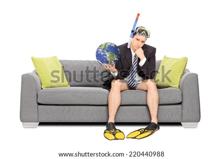 Sad businessman holding the earth and sitting on sofa isolated on white background. Earth image in public Domain and furnished by NASA - stock photo