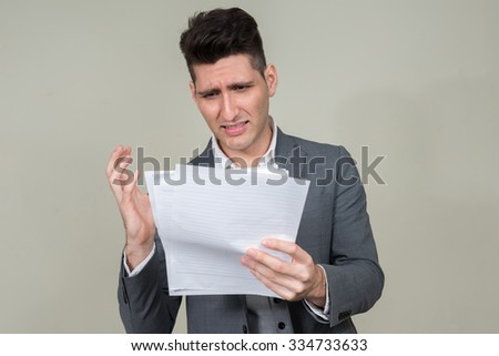 Sad businessman looking papers