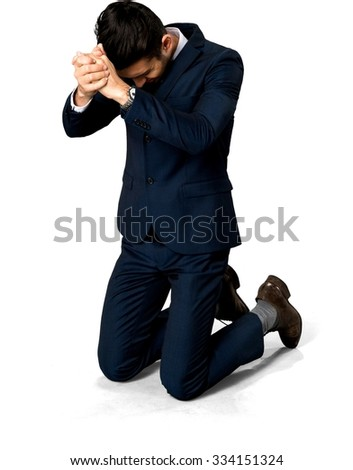 Sad Caucasian man with short dark brown hair in business formal outfit begging - Isolated