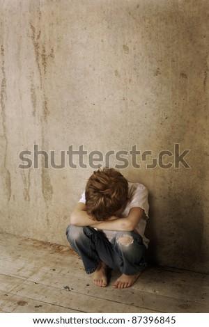 Sad child alone - stock photo
