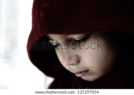 Sad child crying - stock photo