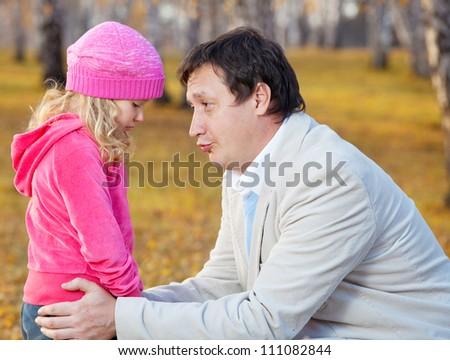 Sad child. Fater daughter regretting - stock photo