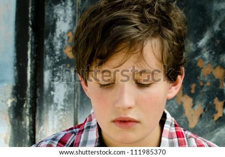 Sad child looking down - stock photo