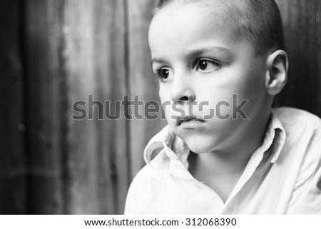 sad child portrait black and white photography - stock photo