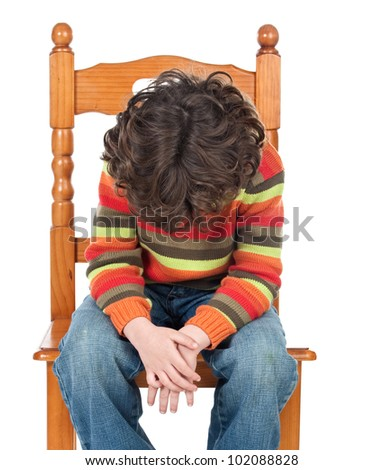Sad child sitting on a chair isolated on a over white background - stock photo