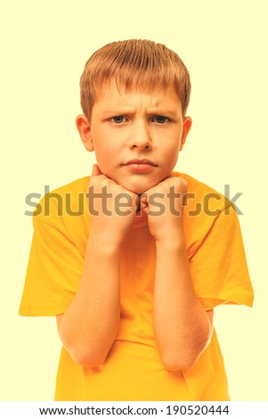 sad child teen blond boy in the yellow shirt is depressed isolated on white background cross processing retro
