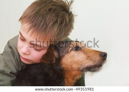 Sad child with the dog - stock photo