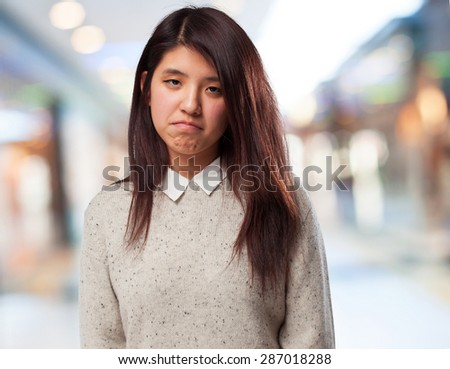 sad chinese-woman standing