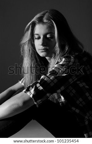 Sad college student. Black and white photography - stock photo