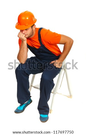 Sad constructor worker sitting and waiting on step ladder isolated on white background - stock photo