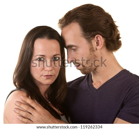 Sad couple embracing over isolated background - stock photo