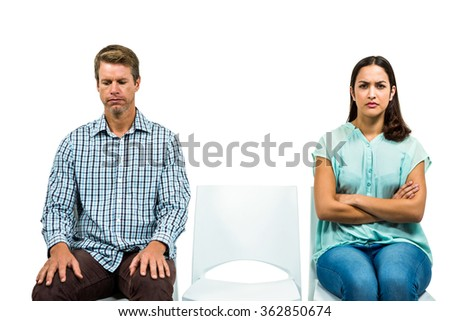 Sad couple not talking after argument on white background - stock photo