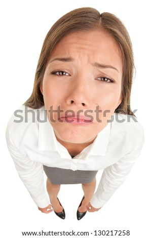 Sad crying disappointed funny business woman in high angle view isolated on white background. Multicultural Asian Caucasian businesswoman looking unhappy isolated on white background. - stock photo