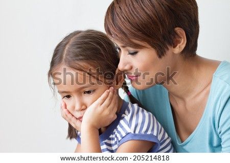 sad daughter and understanding mother, good family life - stock photo