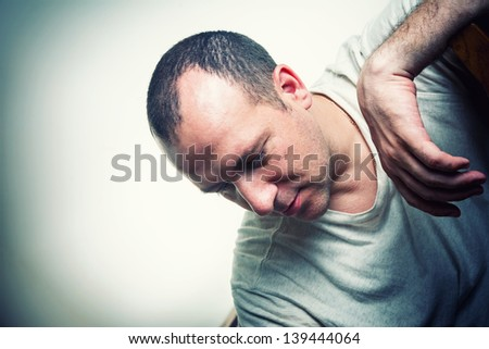Sad depressed mature adult man against white wall background. Copyspace. - stock photo