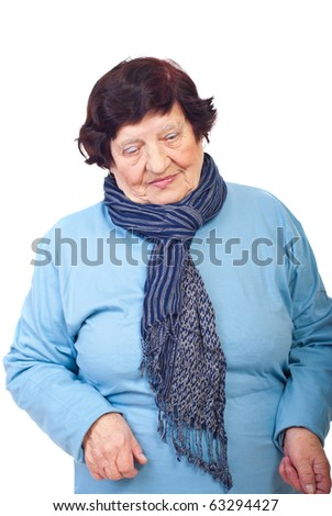 Sad elderly woman looking down isolated on white background