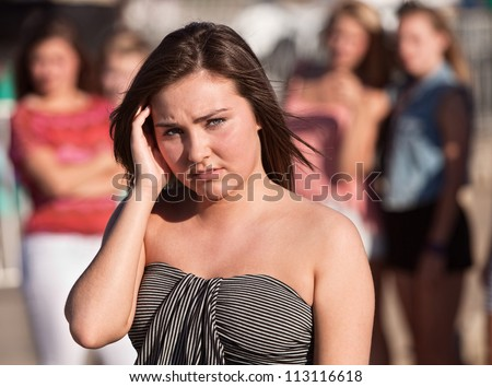 Sad European teenage girl with hand near head - stock photo