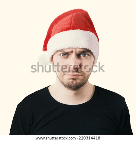 Sad face. Man with a santa hat, Isolated. Color toned image.