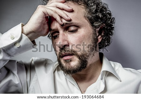 sad face, man with intense expression, white shirt - stock photo