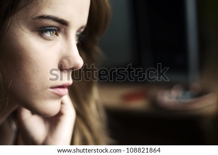 sad face of a beautiful girl - stock photo
