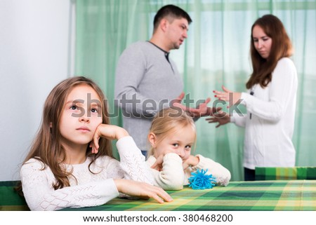 Sad family of four having quarrel at home - stock photo