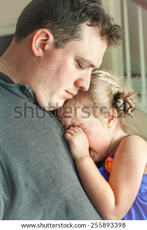 sad father comforting his crying preschool age daughter. Great parenting image - stock photo
