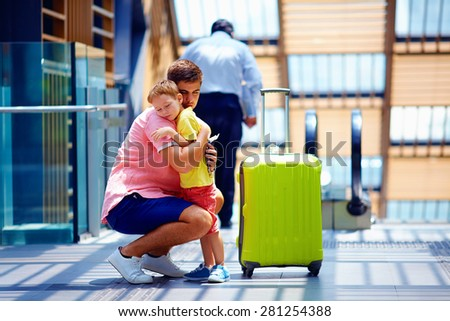 sad father hugging son before leaving in long trip - stock photo