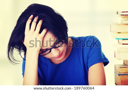 Sad female student with learning difficulties - stock photo