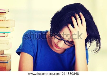 Sad female student with learning difficulties , isolated on white - stock photo