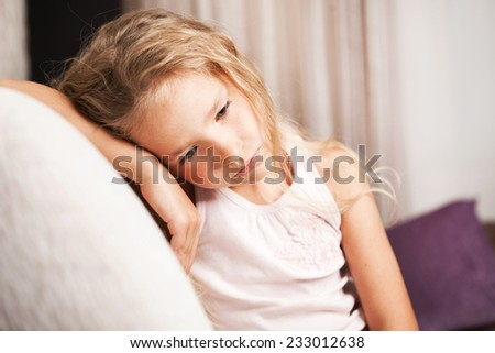 Sad girl at home. Little child stress. Abuse - stock photo