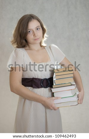 sad girl carrying books under arm