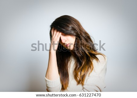 sad girl crying isolated on a gray background
